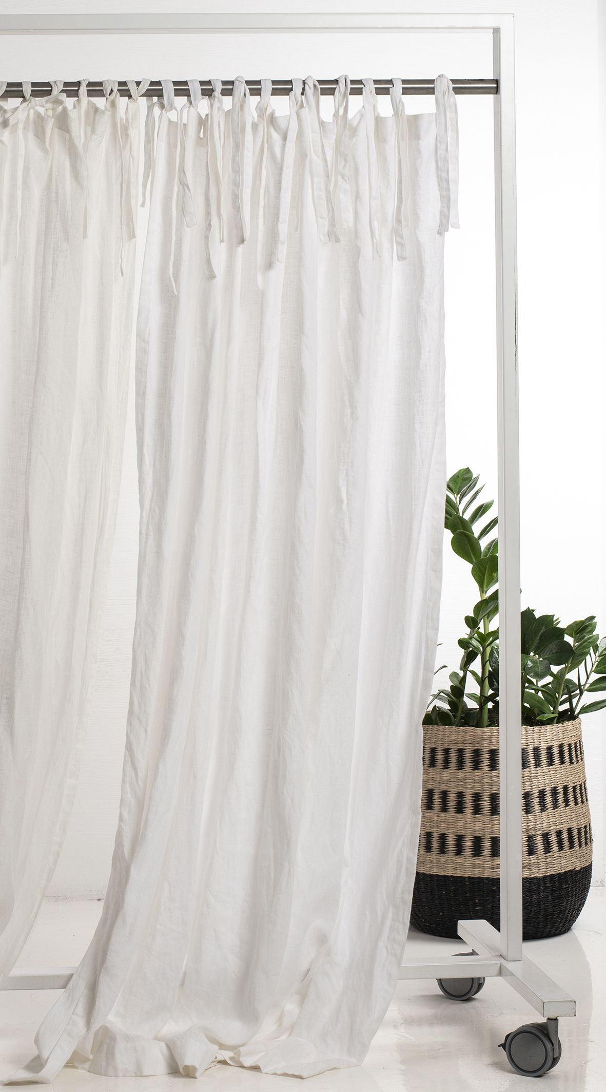 White linen curtains will add a sense of vitality and freshness to every interior