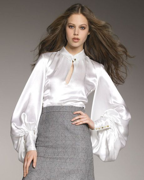 The perfect BLOUSE by Yves St. Laurent: I love everything about this look, the skirt, the hair. This is also a great way to dress up denim. I love a white satin blouse with a crisp black denim!