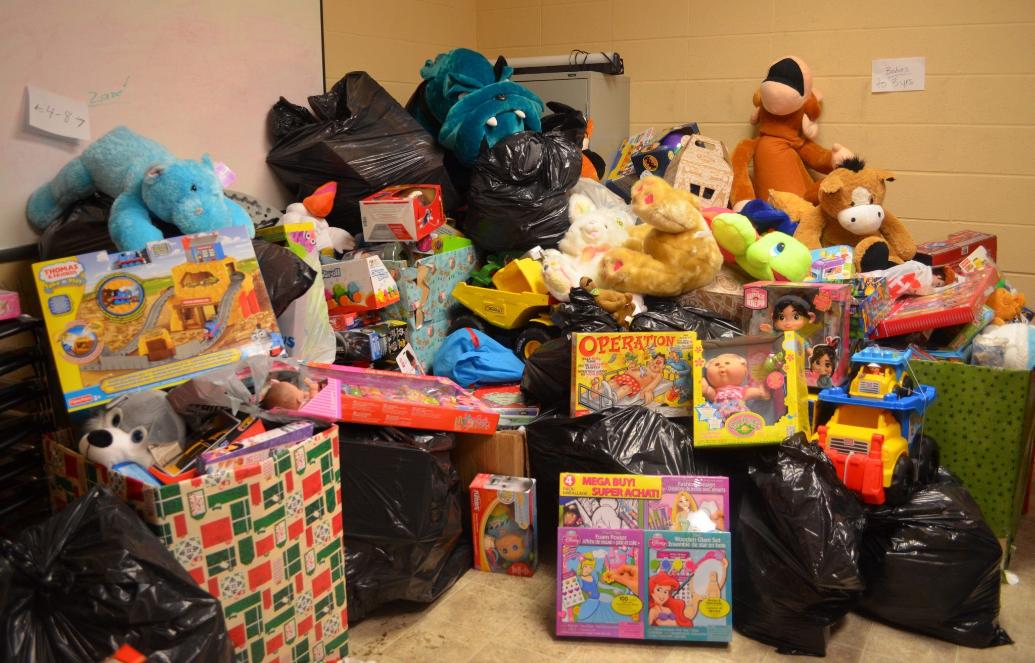 Calgary toy drop of at the Women's Centre. Train the