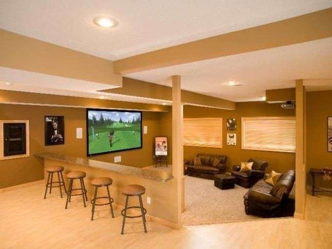 Idee per arredare un seminterrato - Soggiorno e angolo bar nel ...