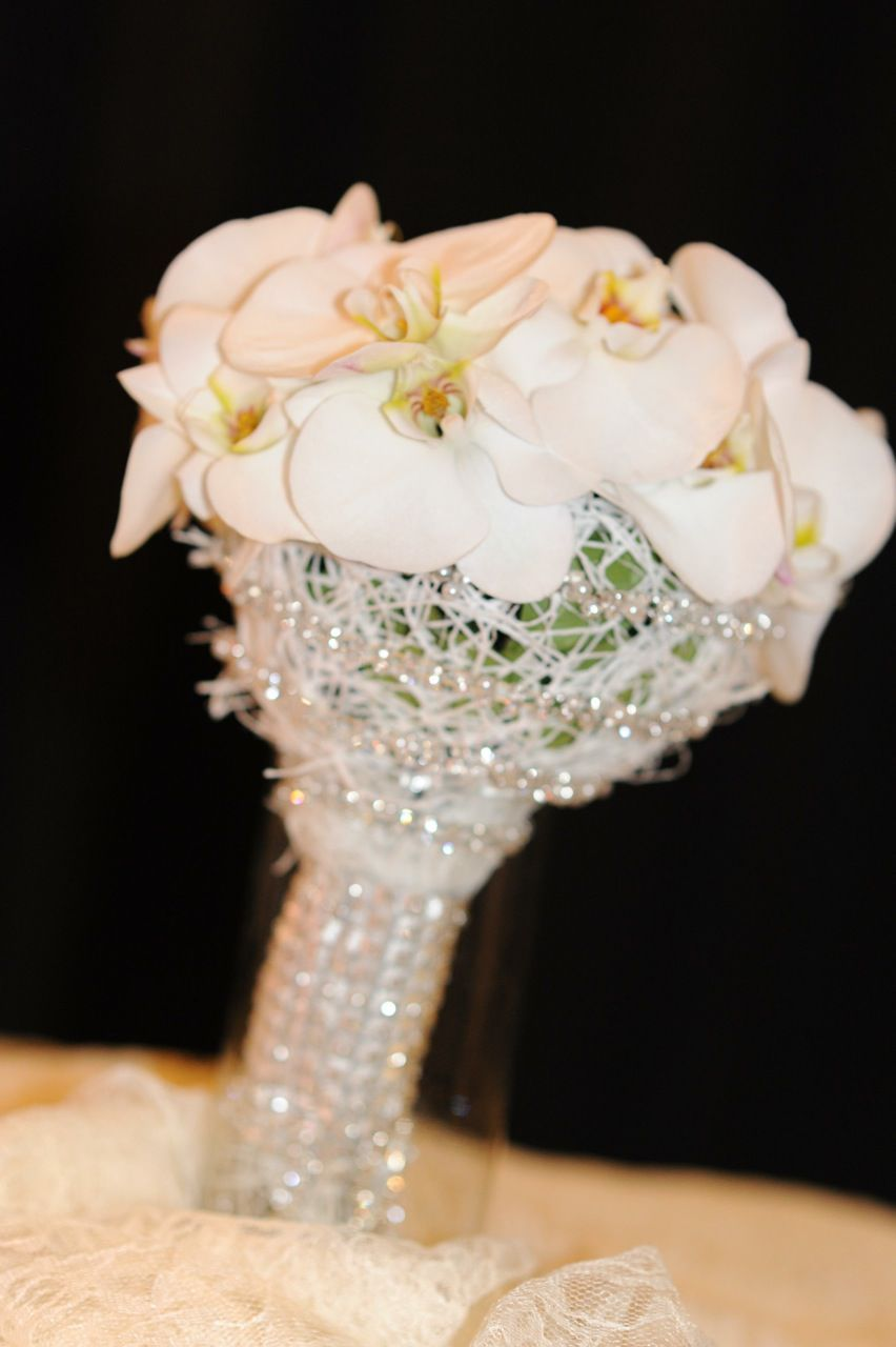White Orchids With Crystal Wrap For This Unique And Chic Bridal