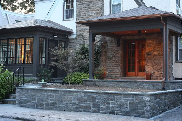 the new stone wall and porch copper gutters and benjamin moore