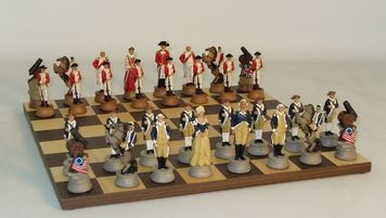 "This amazing American Revolution Themed Chess With Dark Rosewood Board is a collector's dream!  Soldier chess pieces have sharp, painted details on a coordinating ""battlefield"" board! #boardgamesforacafe"