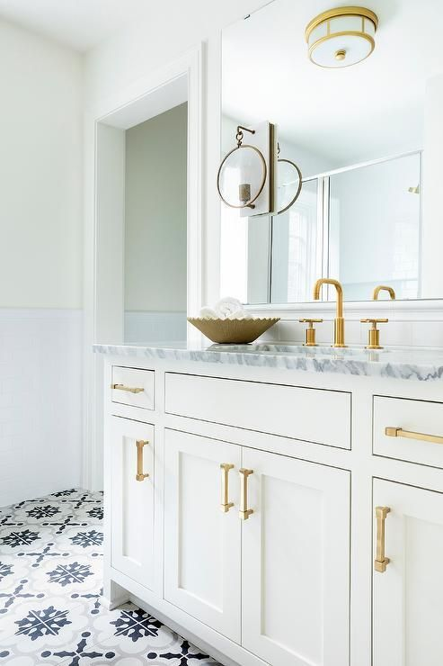 brass and white glass flush mount lights an elegant gold gray bathroom clad in black mosaic floor tiles framing wh  also