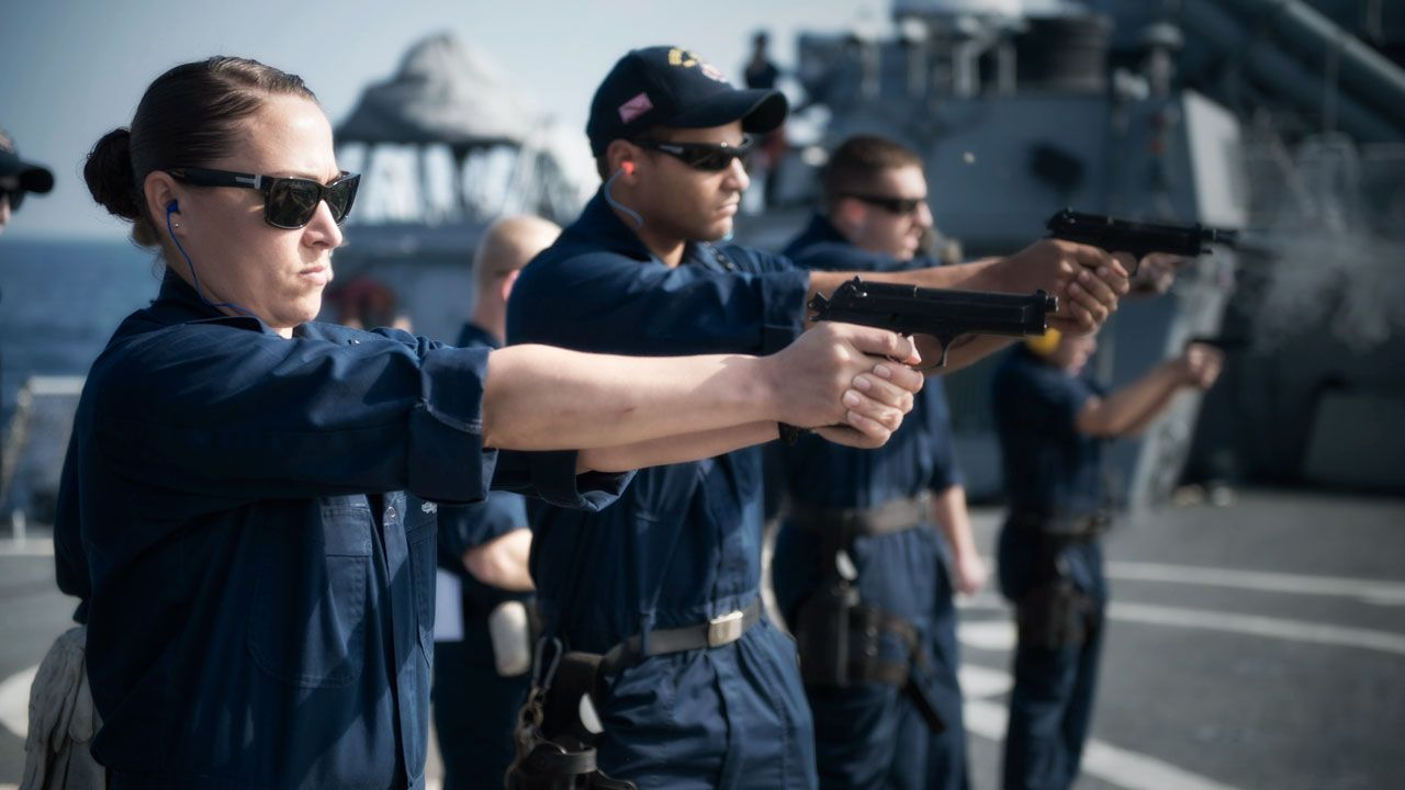 Us Navy Law Enforcement And Security Professional Servicemen Practice With Firearms Medical Alert System Law Enforcement Career