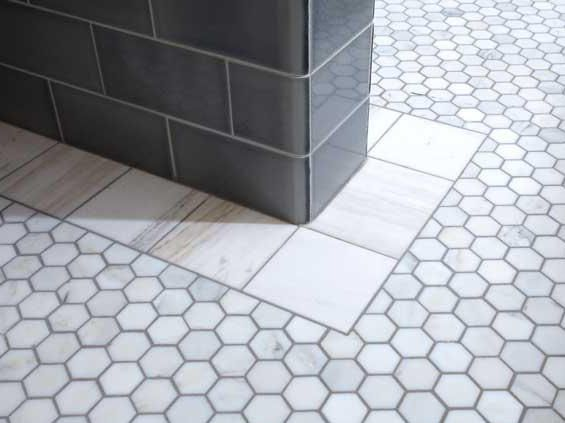 Hexagonal Floor Tiles And The Unusual Hand Cut Border Are Marble.