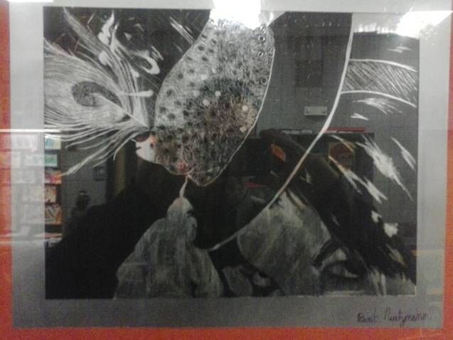 """Daughter's """"scratch-art"""" self-portrait.  She's tipping her hat w/ a peacock feather in it.  (Sorry for the reflection, it was framed for the school art show.)"""