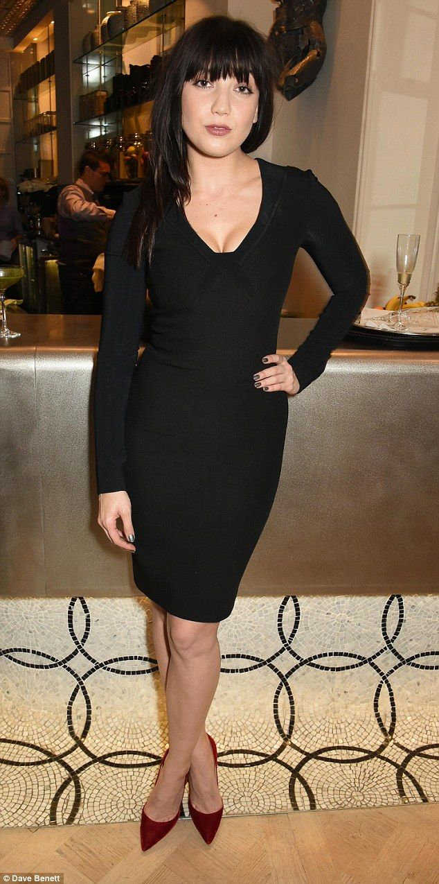 Lowe cut: Daisy Lowe, 26, displayed her glorious assets in a very low cut figure hugging d...