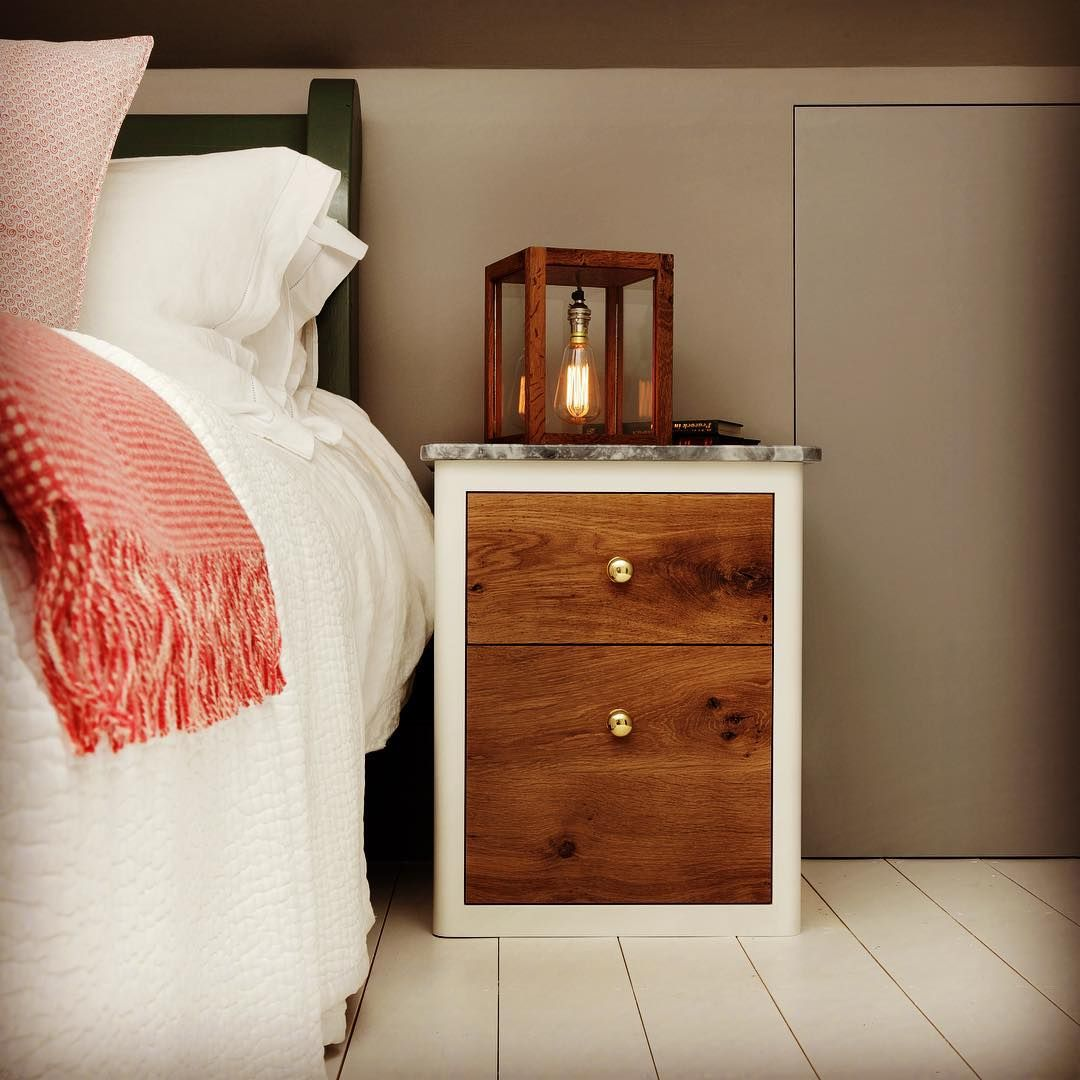 The best dressed bedrooms always boast a beautiful bedside table. This one is called The Eadwig and features burnt oak drawer fronts with brass handles. A dove grey marble top is the perfect finishing touch. We have teamed The Eadwig with our Small Memoria Lamp II, handcrafted from reclaimed wood sourced from London period properties.