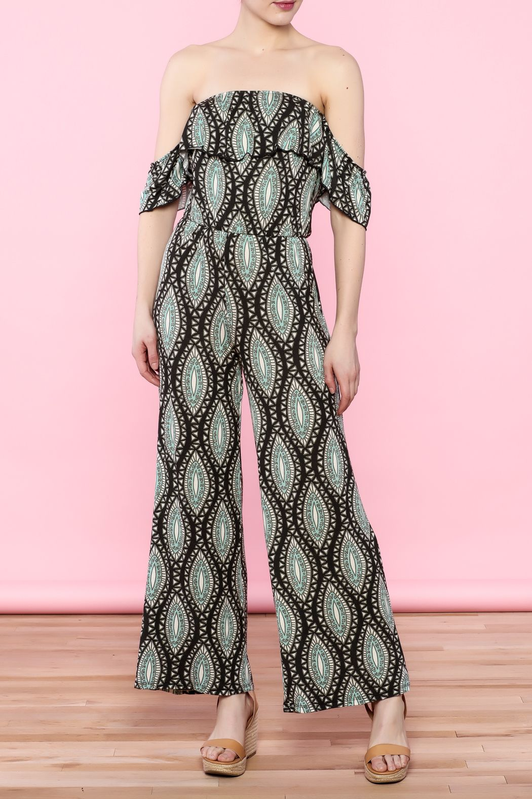 Off-shoulderjumpsuit with black and green pattern print. Elasticized shoulder band and waist.   Off-Shoulder Jumpsuit by Lani Collection. Clothing - Jumpsuits & Rompers - Jumpsuits Palm Beach, Florida