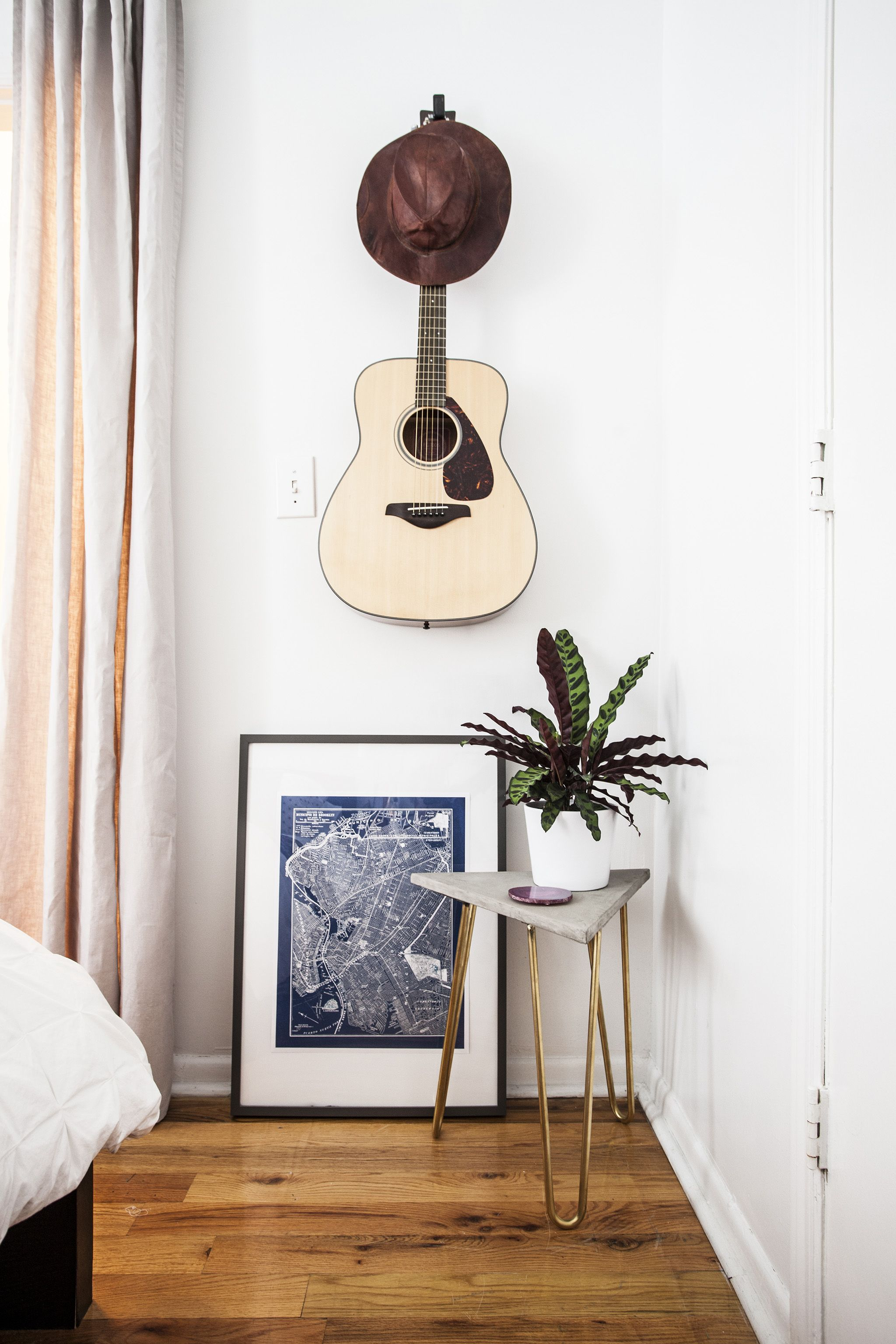 Musical Instruments On A Wall With Artwork Leaned Below. Zelda Table  Designed By Katy Skelton