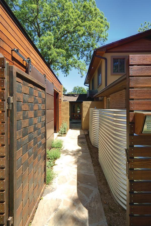 Corrugated Steel Rainwater Tank Wrapped In Cedar Rain Water Collection Water Storage Tanks Rainwater Harvesting