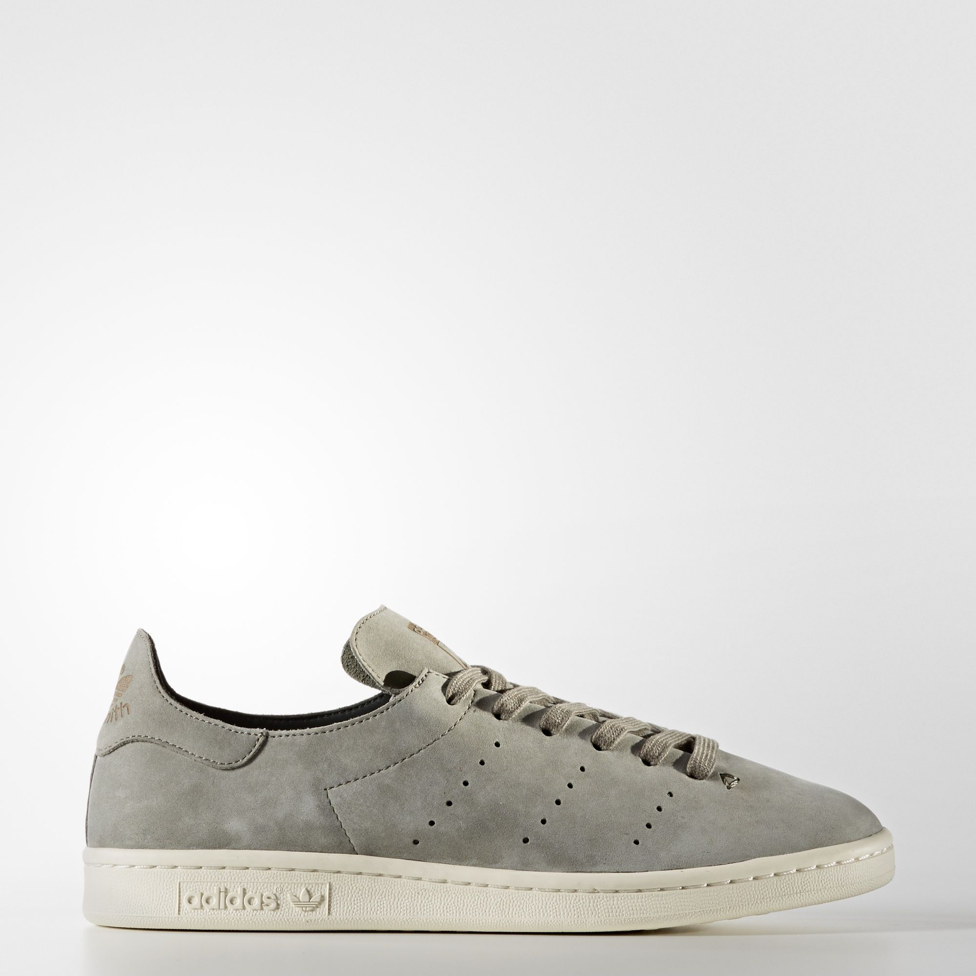 The clean look of the Stan Smith is redefined with a minimalist single-piece nubuck upper. These men's streamlined shoes capture the authentic look of the '70s original with perforated 3-Stripes and a low-profile rubber cupsole.