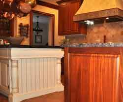 custom kitchen features - furniture like island cabinet, custom range hood, back splash & so much more; #kitchens; #buildremodel; #homeowners; #hometips4women