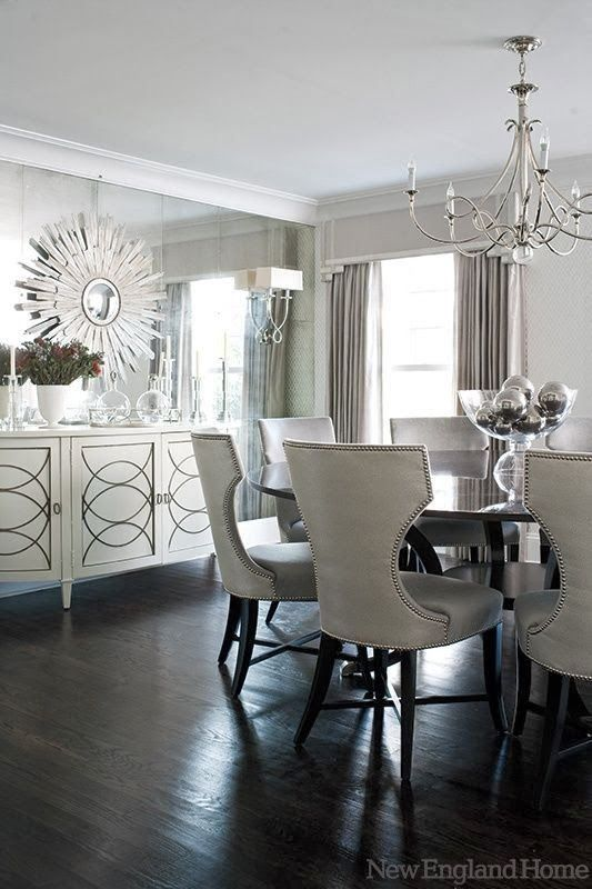 Round dining table with Leather Stud Trimmed Chairs silvia - comedores elegantes