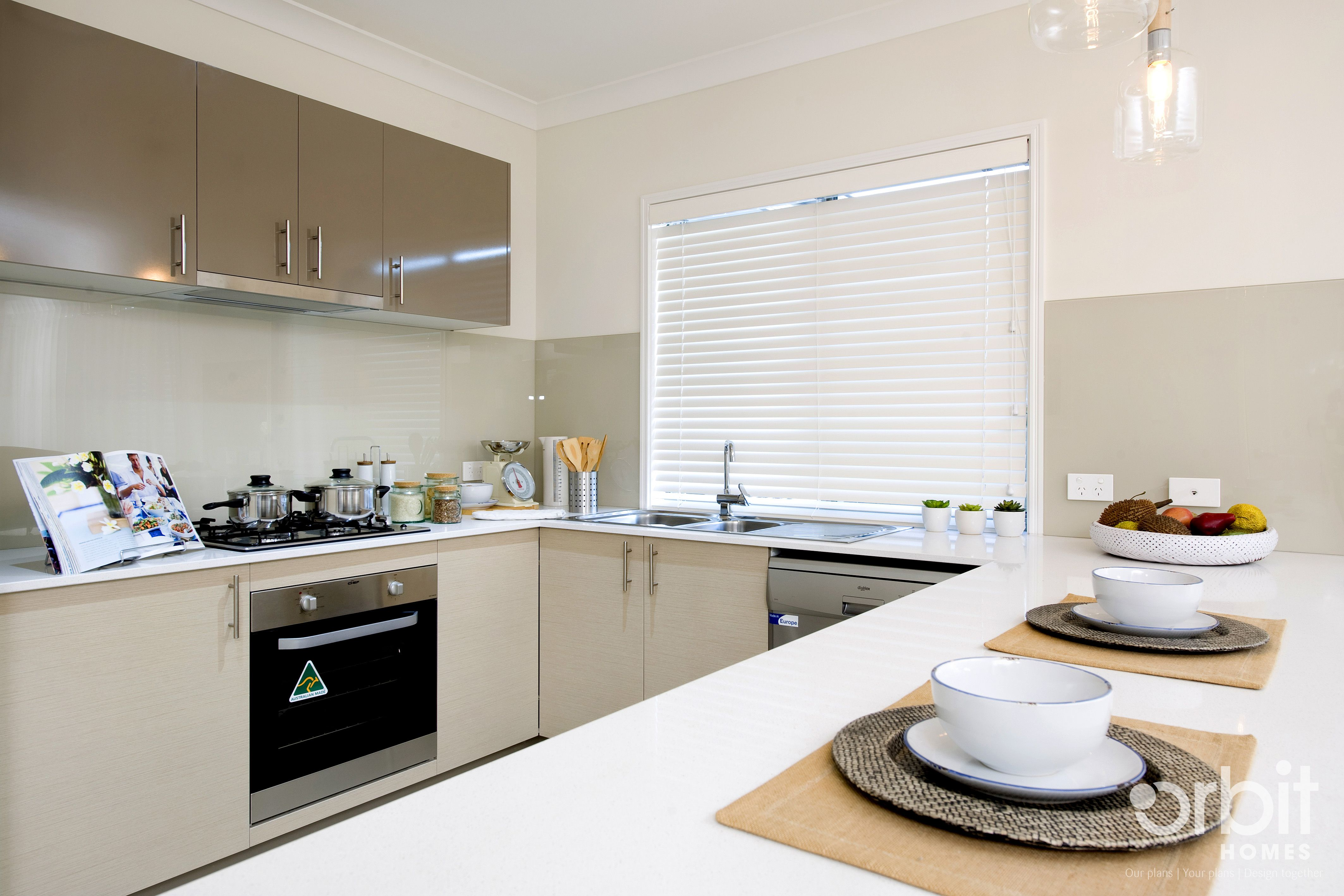 A ultra modern and sleek kitchen design, with stainless