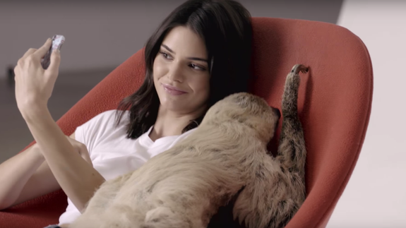 Kendall Jenner got to chill with a sloth. WTF.
