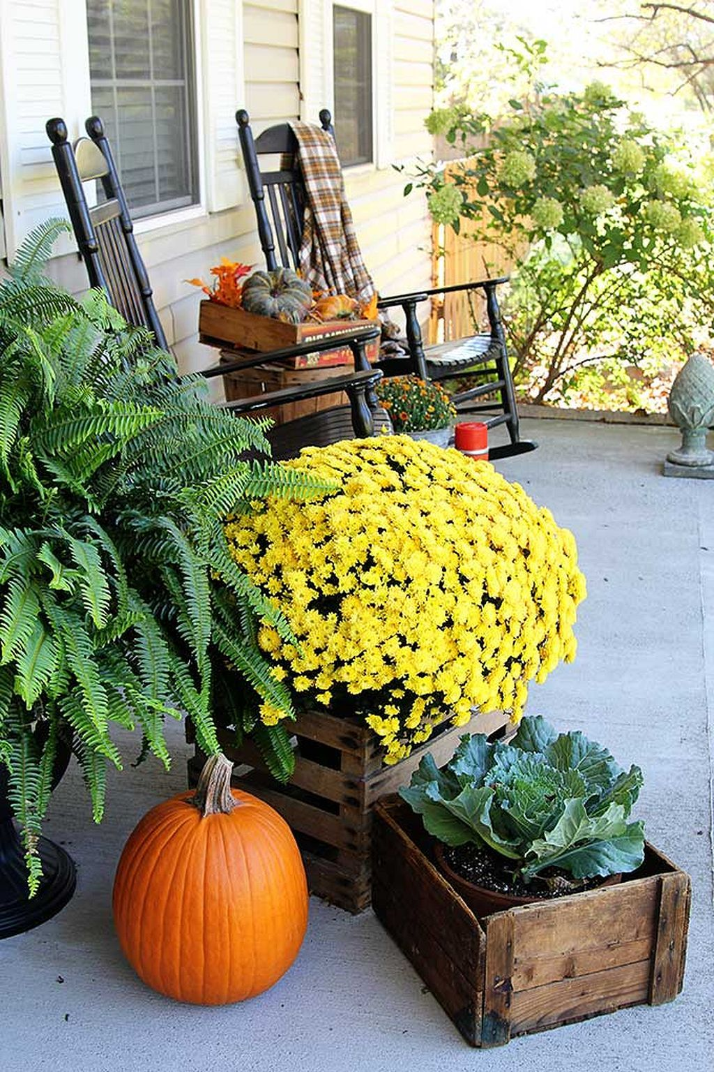 Festive front porch fall decor mixing traditional