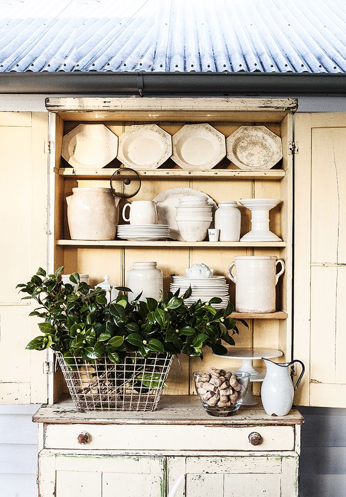 white dinnerware in an antique hutch