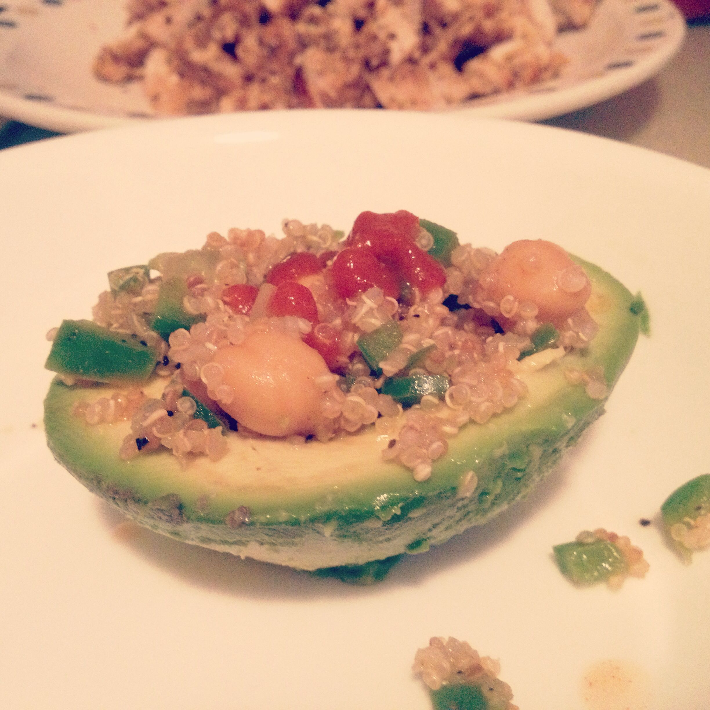 Stuffed avocado with quinoa,chick peas, and green peppers, topped with few drops of hot sauce (of course ;) )