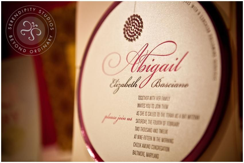 Round invitation with embellishment. Perfect for any grand event.
