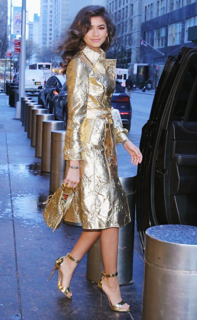 Zendaya in a gold trench coat