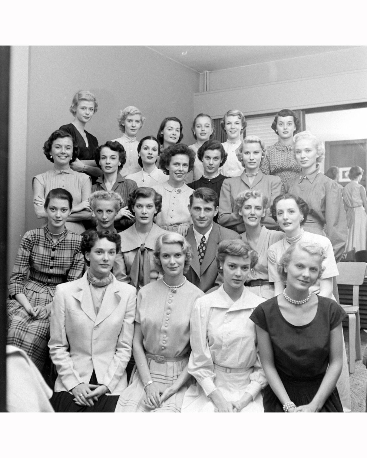 The Ford Model Agency, Joan Pedersen 2nd girl from the right, on third row from the bottom, with choker necklace. Photo Nina Leen
