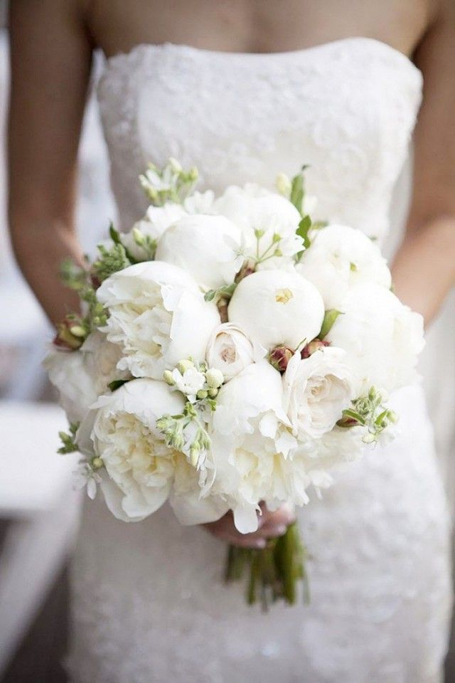 A bouquet of one type of bloom in one color is simple yet wildly elegant, as seen here in this all-white posy of peonies at different stages of bloom. The shape of this type of bouquet is called...