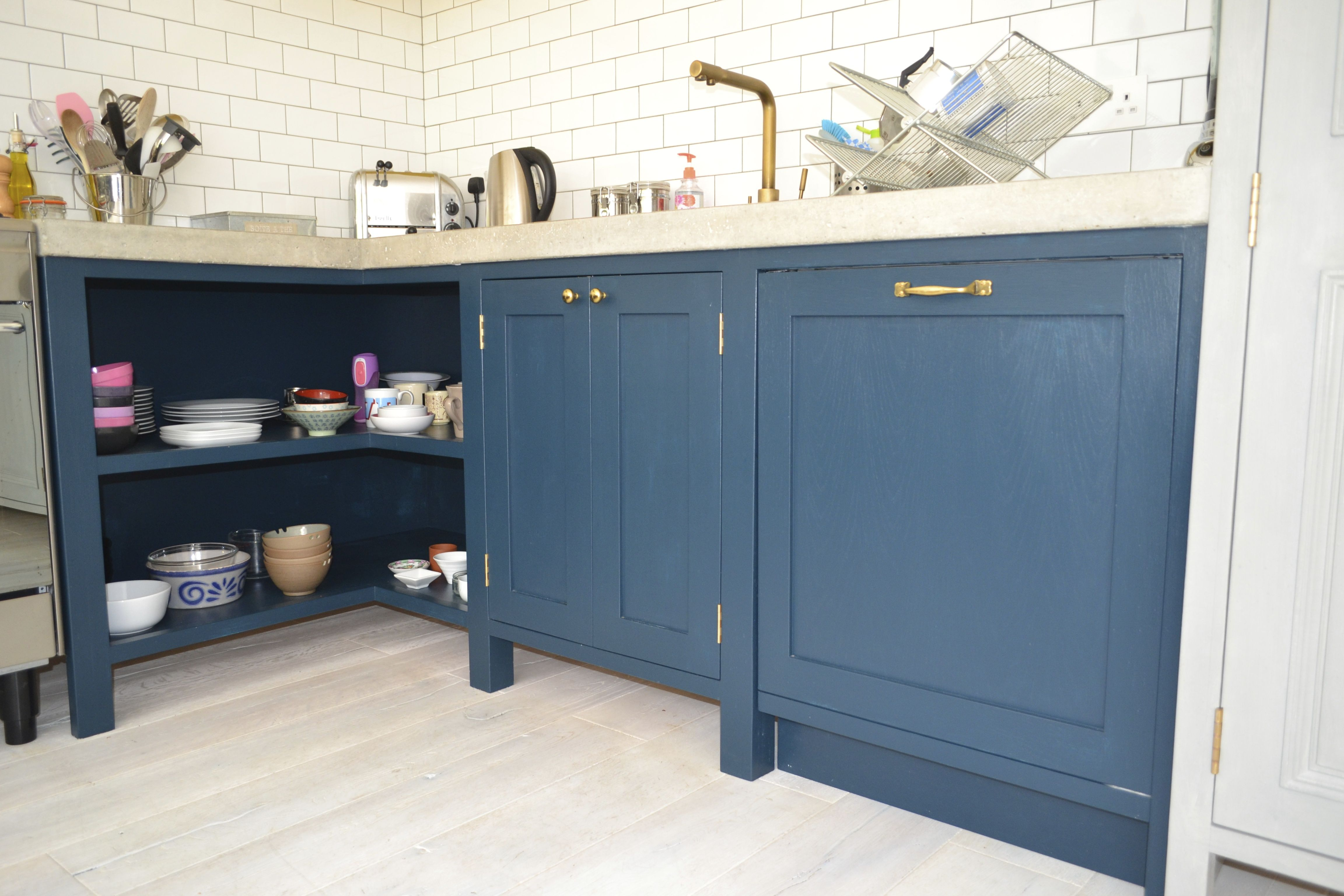 Bespoke kitchen with open corner storage, vintage polished brass ...