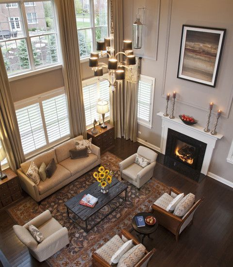 Great room love the molding to break up the tall wall - Family room wall decor ideas ...