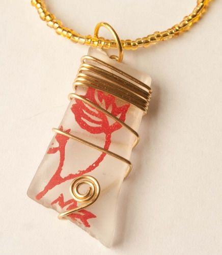 Perfect for summer: Gold and Red Wire Wrapped Seaglass Pendant, up for auction starting at $4.