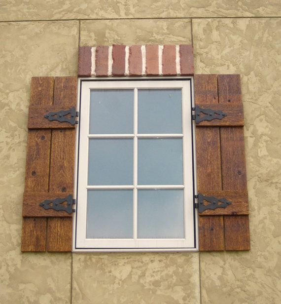 Wooden shutters with hardware on brick let 39 s go - Exterior wooden shutters for windows ...