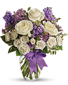 white roses and purple stock mix with delicate lavender