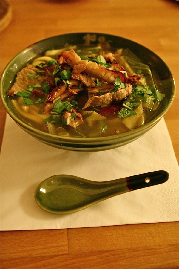 Chinese noodle soup with Peking duck meat, shitake mushrooms, bok choi, ginger, spring onion, sherry and coriander. Effecient way of using leftovers from Peking duck. - Leave a comment!