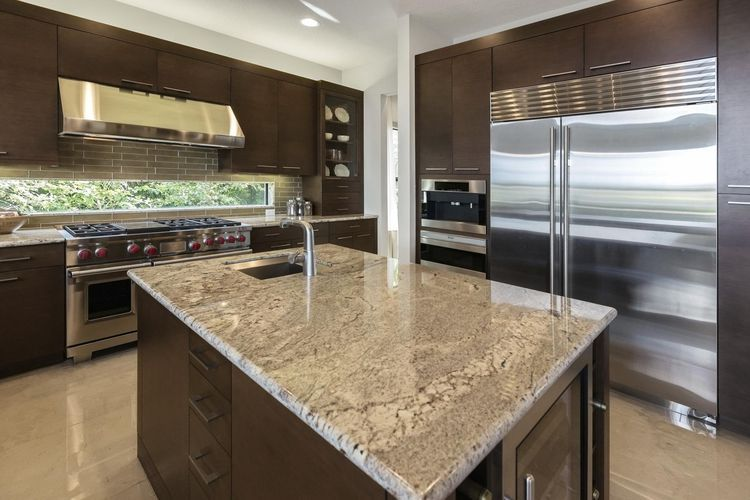 Insider Secrets For Sealing And Removing Stains On Granite Counters Kitchen Countertops Kitchen Cabinet Door Styles Kitchen Countertop Materials