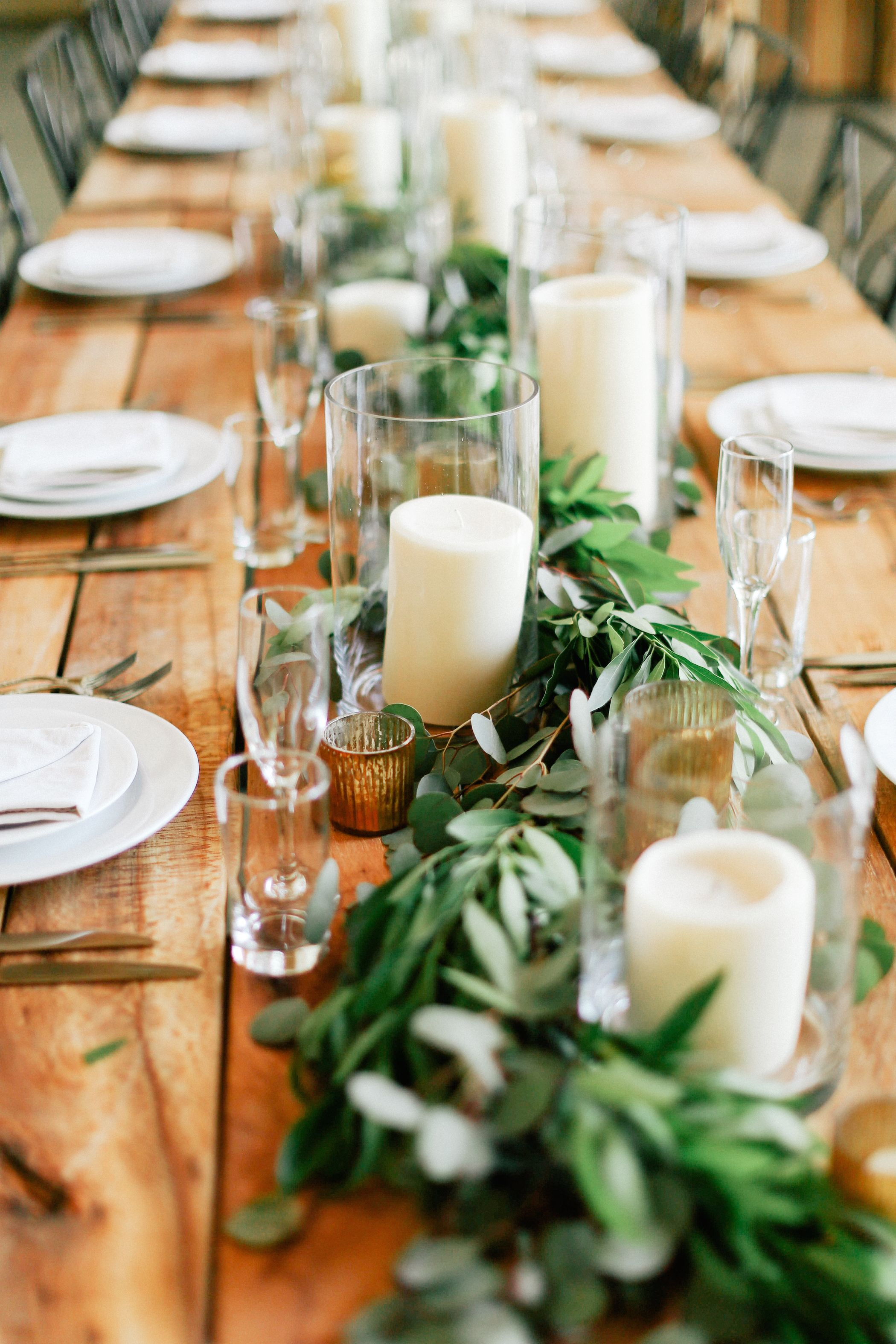 The Head Table Will Feature A Runner Of Greenery Silver Dollar Eucalyptus Magnolia Leaves And Italian Ruscus Accented By Varied Heights Pillar Candles