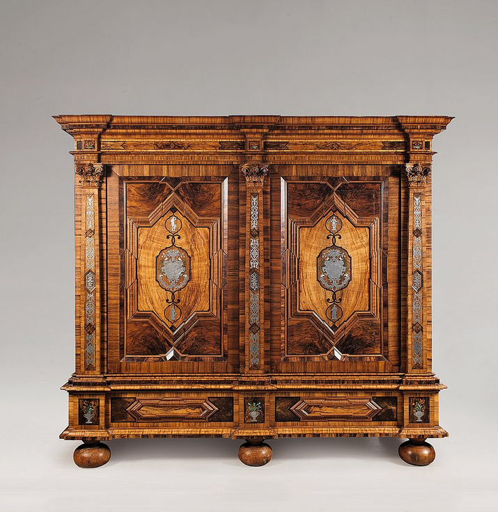 A Brunswick architectural cabinet. Inlaid with palisander, walnut, maple, tin and coloured ivory on wood. Decorated with allegories of Caritas, Spes, Iustitia and Melancholia, the tin inlays engraved with mythological scenes - 1st quarter 18th C.