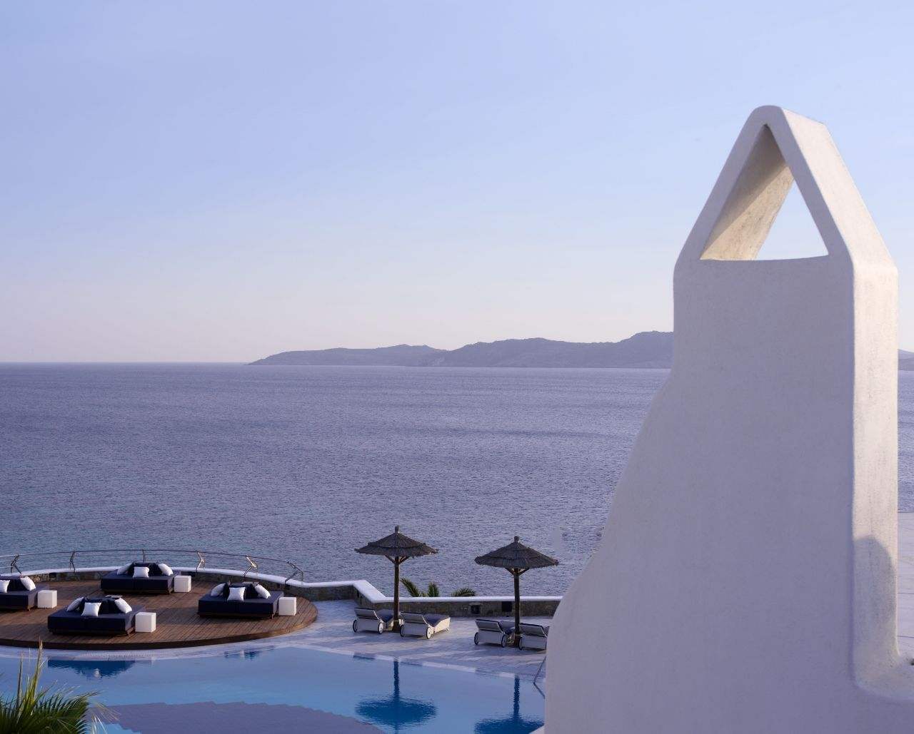 The chimney is located above the main pool area - Mykonos Grand Hotel & Resort