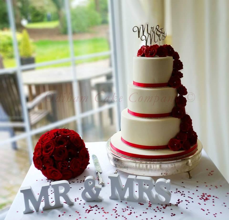 OCC - Mr & Mrs  lovely cascading roses cake. #wedding #cake #cascadingrose #rose