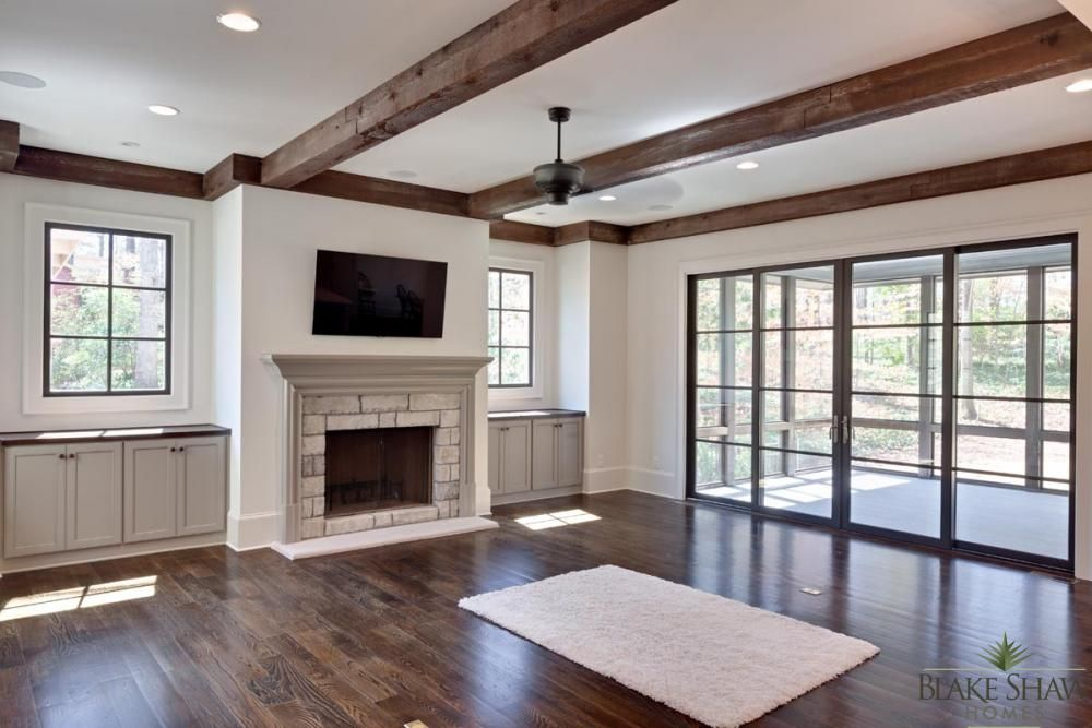 Stone And Wood Make A Dark Masculine Interior: Great Room With Stained Cedar Beams, Oak Flooring, Custom