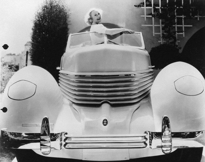 Sonja Henie posing wIth her 1936 Cord 810