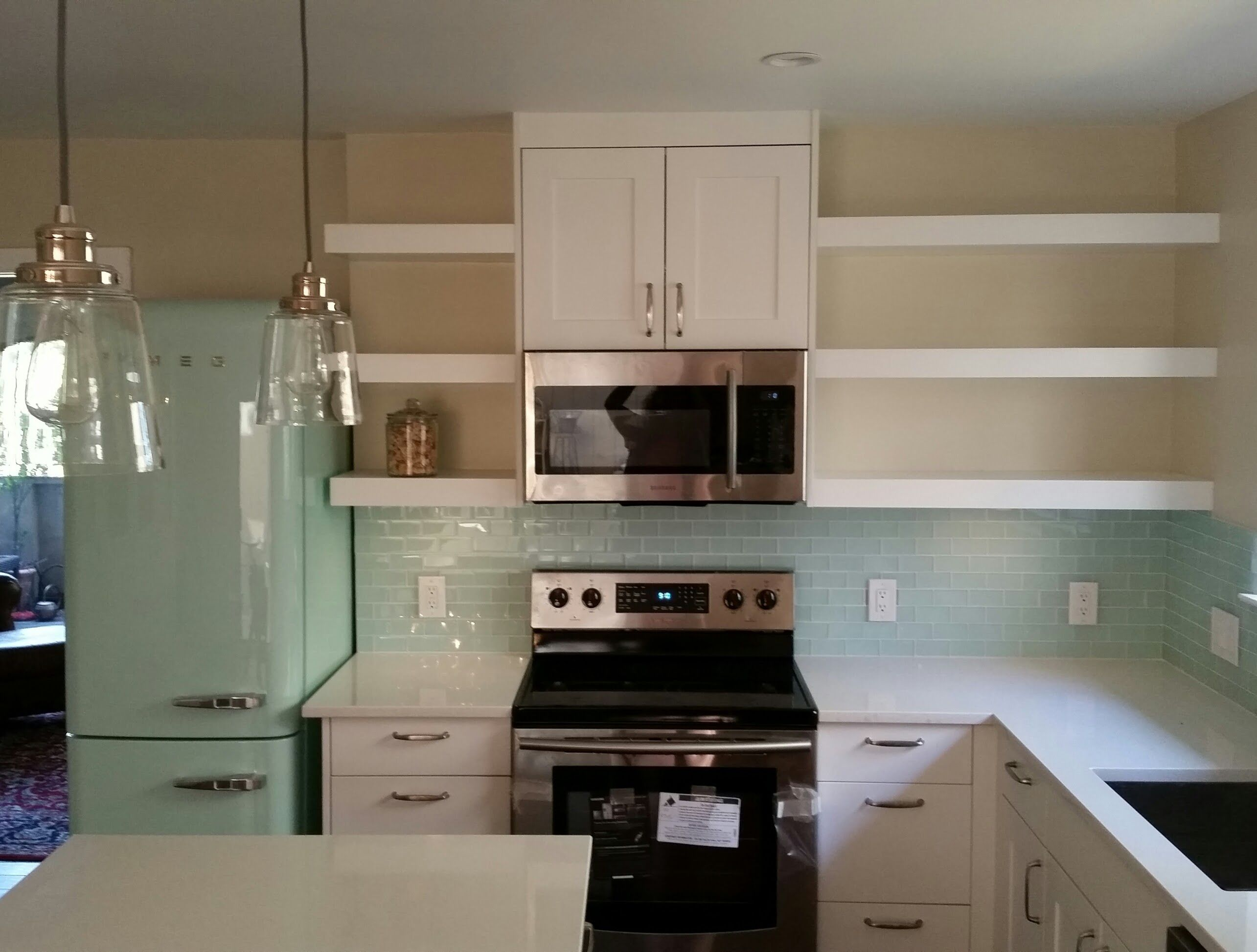 SMEG mint fridge glass tile samsung OTR microwave with vent hood