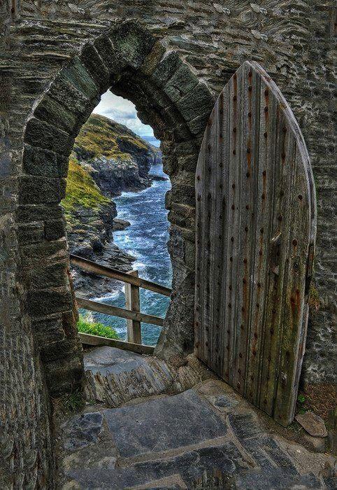 Rustic wood door with brick arch.