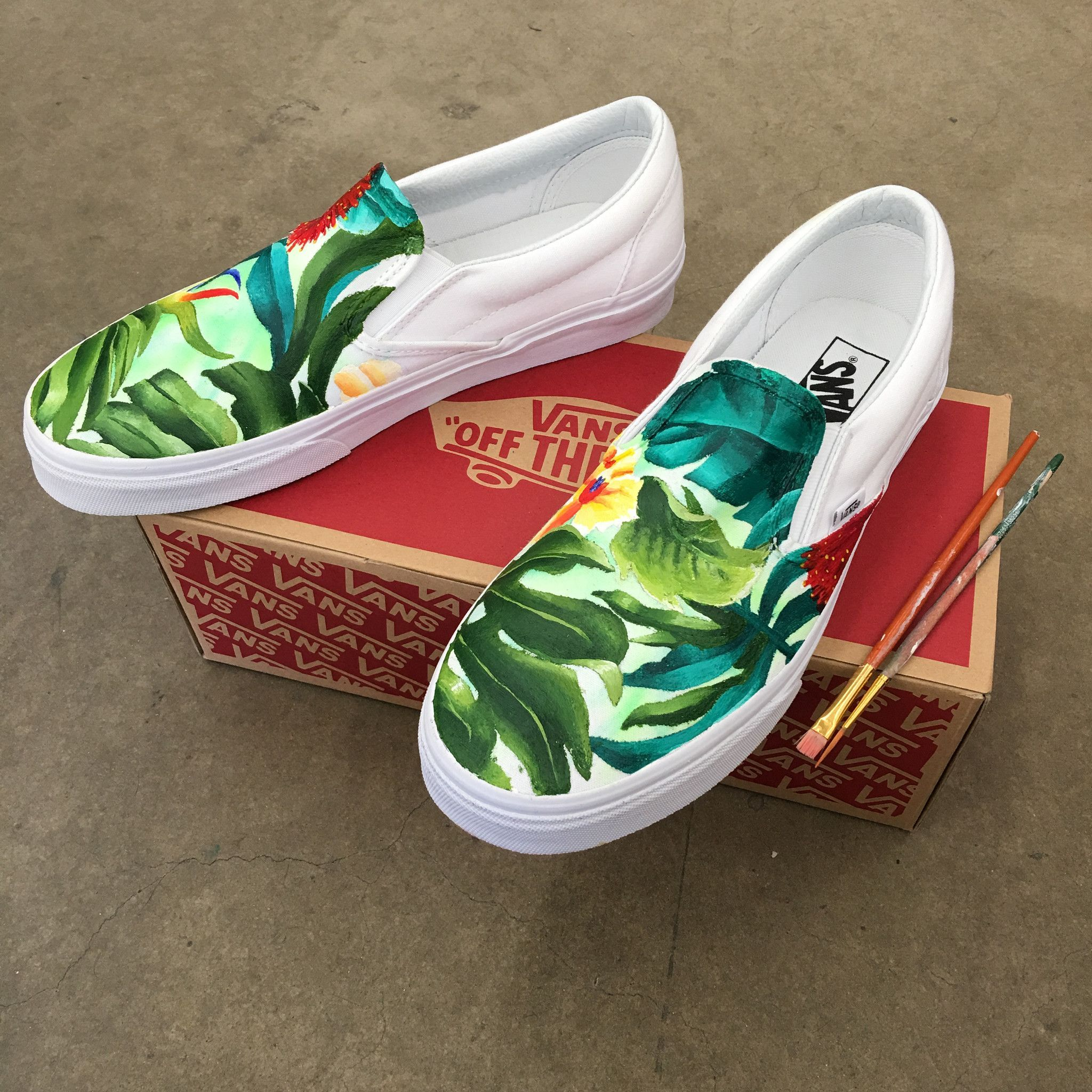 bd56a0cd49fd43 These custom hand painted Vans have been painted with a tropical floral  pattern all over. These custom shoes started out as true white slip on vans.