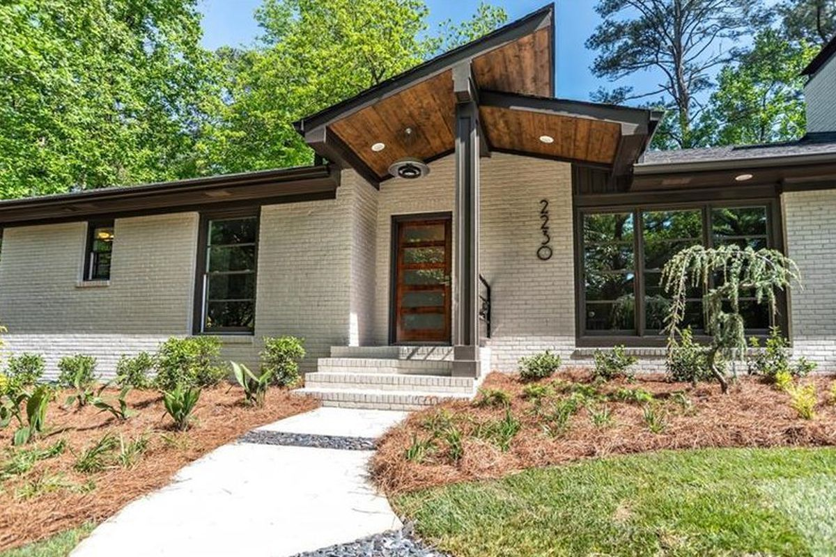 tall windows, two leveled extension over roof. | Ranch ...