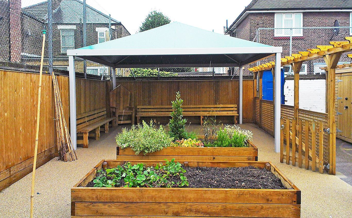 Small canopy covering a garden area. Could also be useful for smoking shelters. & Small canopy covering a garden area. Could also be useful for ...