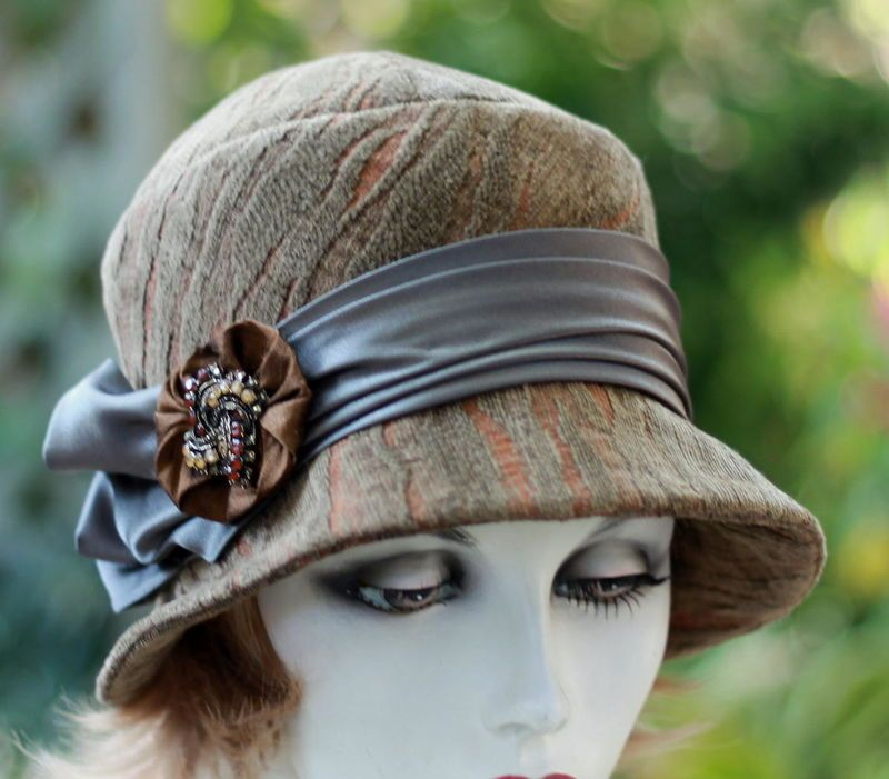 Look spectacular for the fall and winter season in this handmade designer  fabric women s 1920 s cloche hat. Made in a soft velvet fabric in a  swirling ... 1e27265b8d03