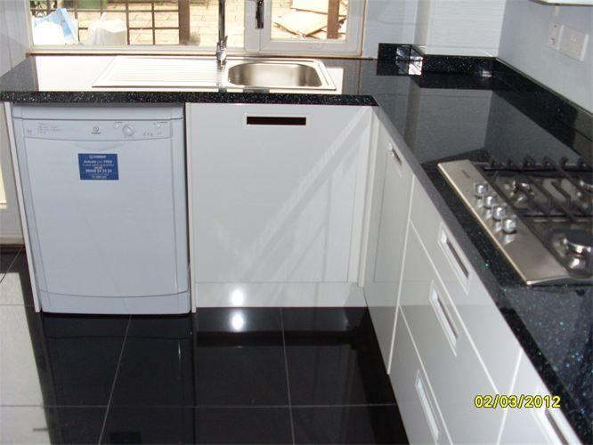 B Q Cooke Lewis Range High Gloss Black Floor Tiles High Gloss Black Tile With Dark Grouti White Kitchen Cabinets Diy Kitchen Floor Tile Black Gloss Kitchen