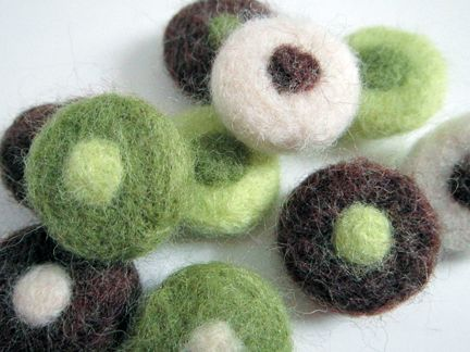 Learn to make needle felted pancake beads at http://loops.typepad.com/serendipity/2012/01/making-a-needle-felted-polka-dot-bead-.html