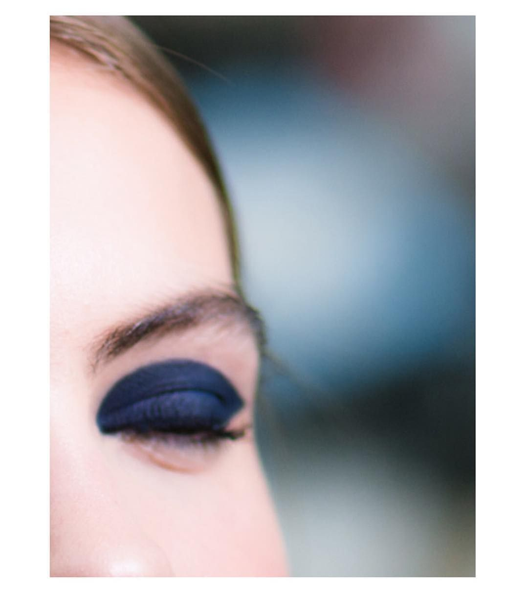 Focus on the blue matte graphic eye makeup created by ...